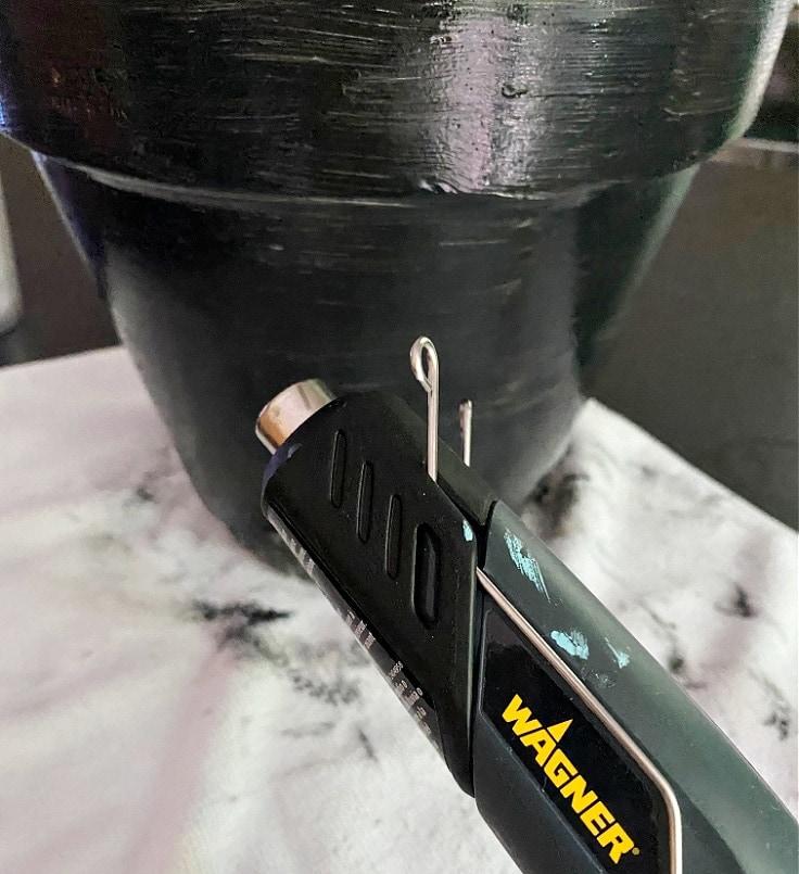 Using heat gun to dry paint.