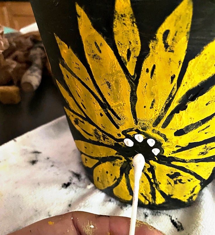 Adding polka dots with a q-tip to the sunflower.