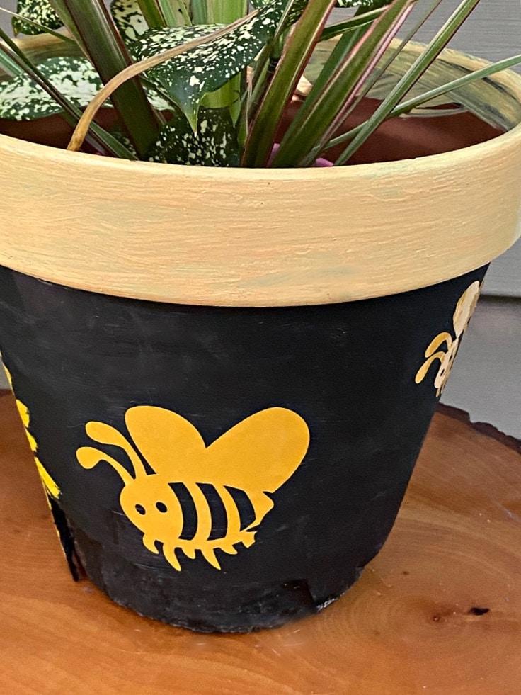 Close up of vinyl bumblebees on flower pot.