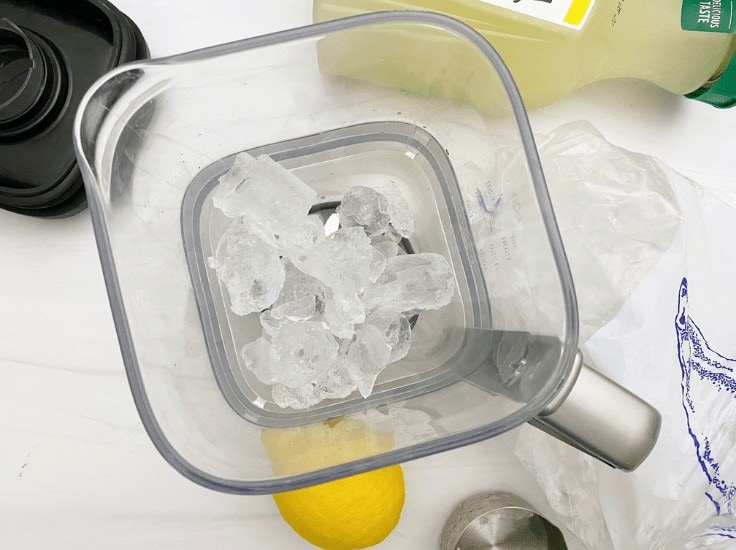 Add some ice to your blender to start making frozen lemonade.